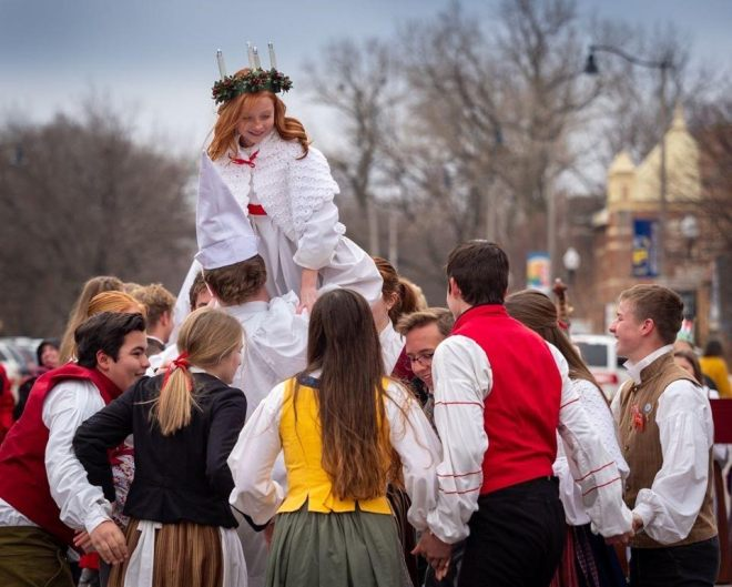 Group gathered for an outdoor festival in Lindsborg, Kansas. As featured in The Best Small Towns and Cities to Visit in the Midwest by The Haute Seeker