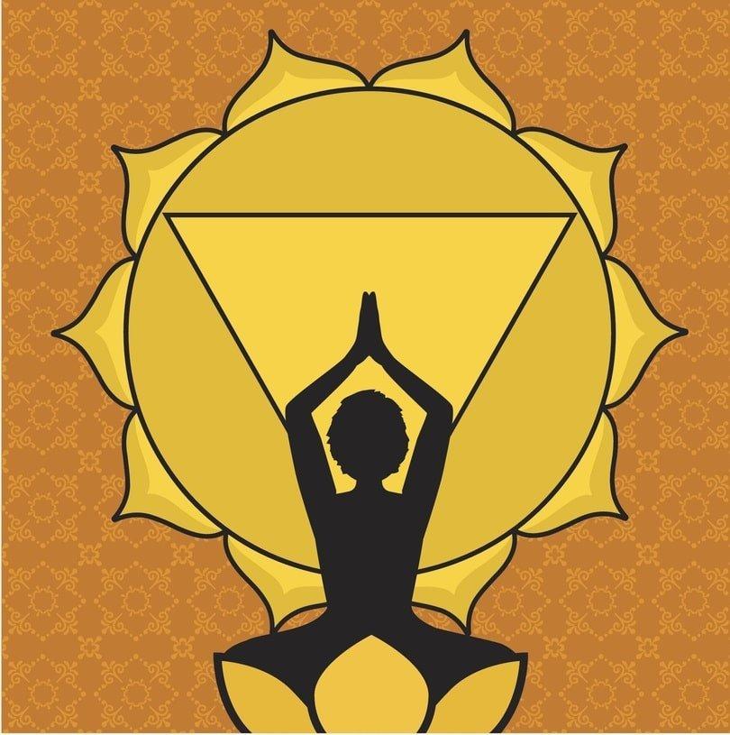 woman practicing yoga in front of solar plexus chakra symbol