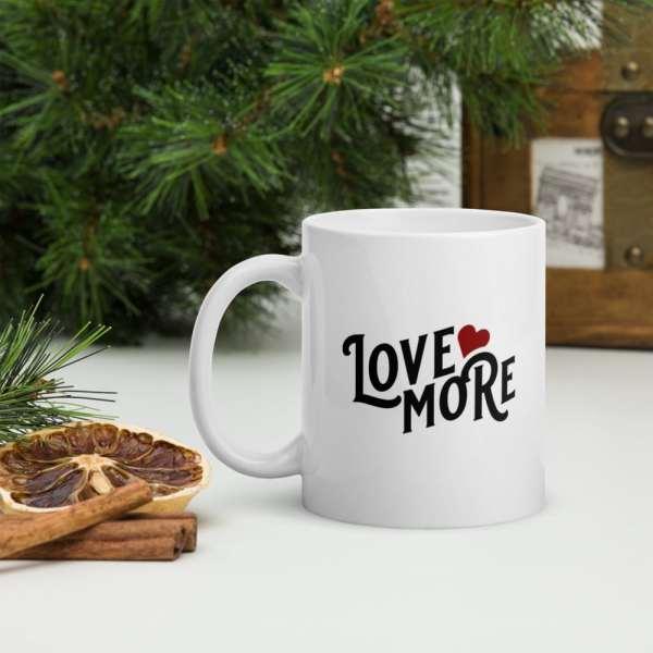"white glossy ""love more"" mug"