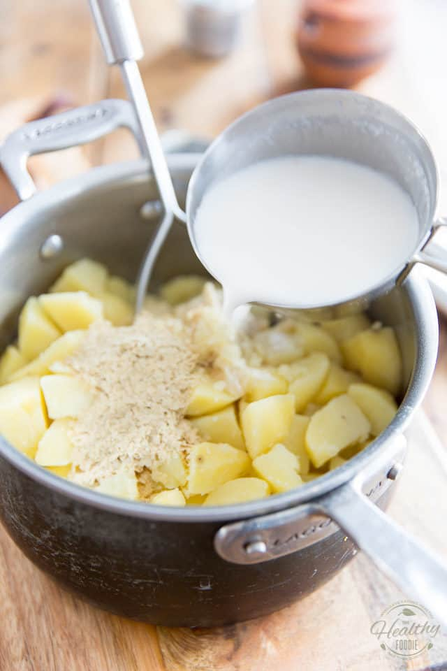 Return them to the pot, add a little bit more than half of the warm milk, the vegan butter and nutritional yeast