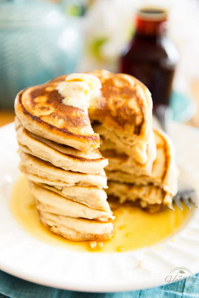 Quick and easy to make, these Light and Fluffy Vegan Pancakes are the ultimate comforting Sunday breakfast! Guaranteed to please everyone - no one will never know they're made with whole wheat flour!