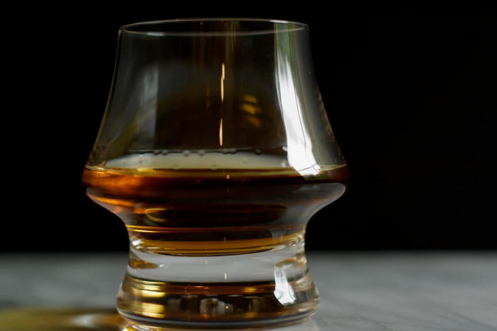 a glass of bourbon neat