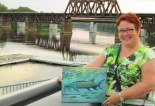 """Artist with """"River Sturgeon"""" painted during the Salsa Piquante concert"""