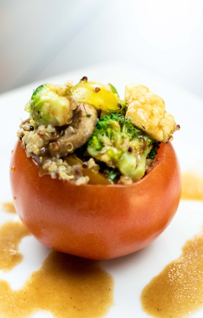 roasted veggie and quinoa stuffed tomatoes with a balsamic dressing drizzle