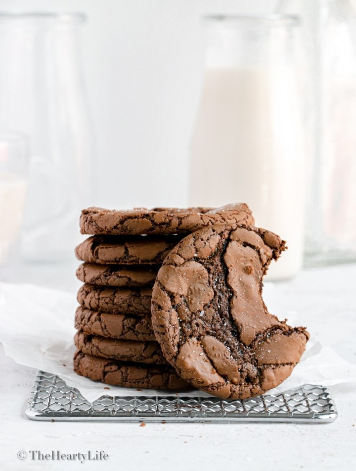 stack of cookies on a cooling rack, one with a bite taken
