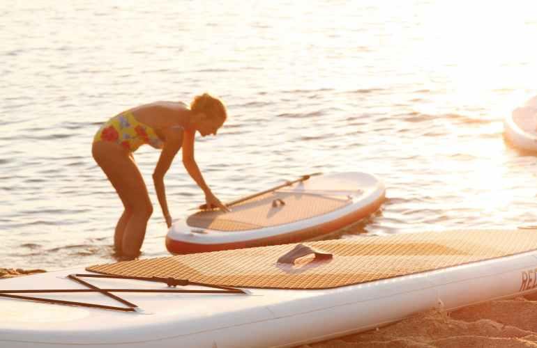photo of paddleboard on seashore