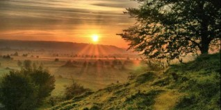 http://commons.wikimedia.org/wiki/File:Sunrise_from_Burrow_Mump,_Burrowbridge,_Somerset_(2931443808).jpg