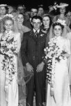 http://commons.wikimedia.org/wiki/File:StateLibQld_1_106704_Family_and_friends_gather_at_this_double_wedding_in_1939.jpg