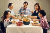 http://commons.wikimedia.org/wiki/File:Family_eating_meal.jpg
