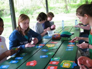 http://commons.wikimedia.org/wiki/File:Homeschoolers_playing_Dutch_Blitz_at_picnic_gathering.jpg