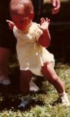 Baby-in-diaper-learning-to-walk-wikimedia-share-alike-license