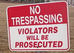 http://commons.wikimedia.org/wiki/File:No_Trespassing_sign_at_empty_lot_in_February.JPG