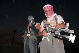 https://commons.wikimedia.org/wiki/File:Iraqi_insurgents_with_guns.JPG