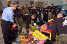 https://commons.wikimedia.org/wiki/File:US_Navy_051219-N-0733J-002_U.S._President_George_Bush_lends_a_hand_in_this_year's_Toys_for_Tots_campaign_by_loading_up_sacks_of_gifts_at_the_Marine_Corps_Reserve_Center.jpg