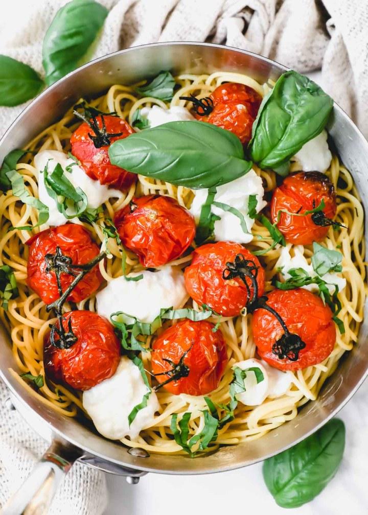 Roasted Tomato Burrata Spaghetti with basil flatlay.