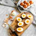Jammy soft boiled eggs on cutting board