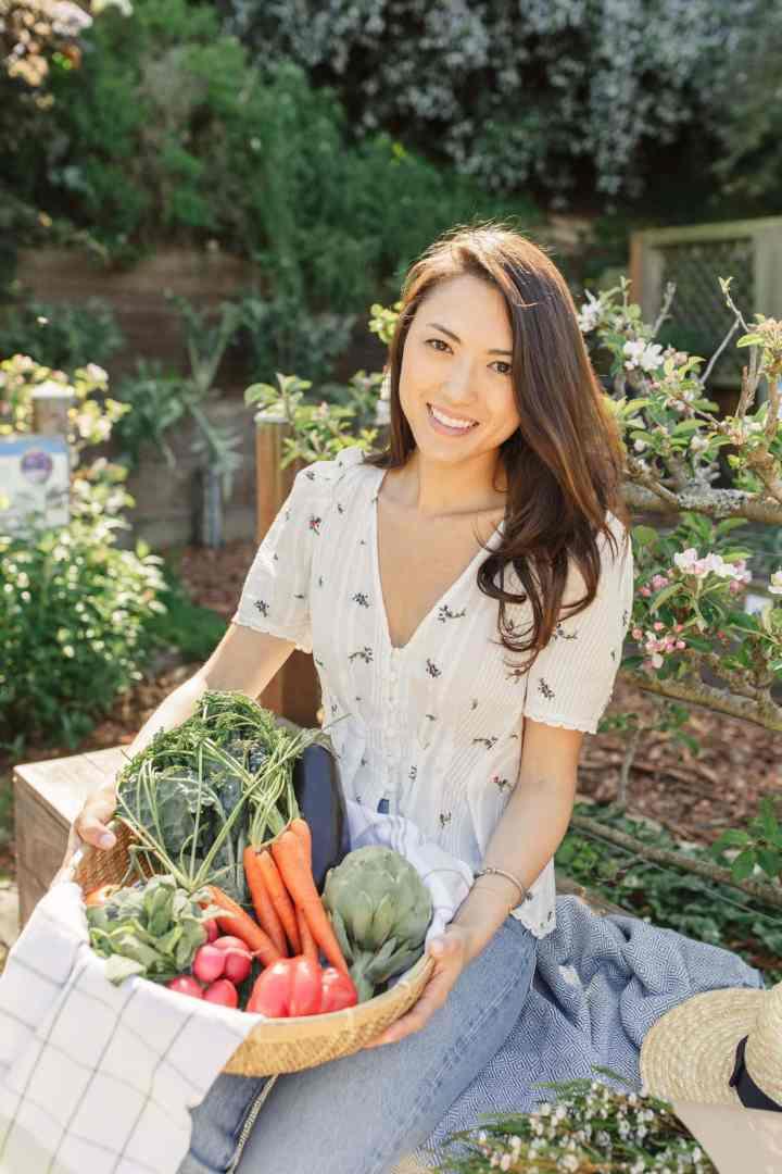 Kat Higashiyama sitting in garden headshot The Heirloom Pantry