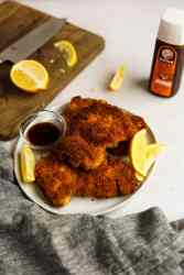 chicken Katsu cutlet with lemon wedges