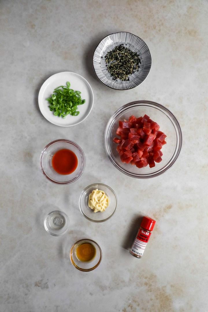 Spicy Ahi Poke Bowl Ingredients. Ahi tuna, furikake, scallions, togarashi, sesame oil, Sriracha, kewpie mayo, mirin.