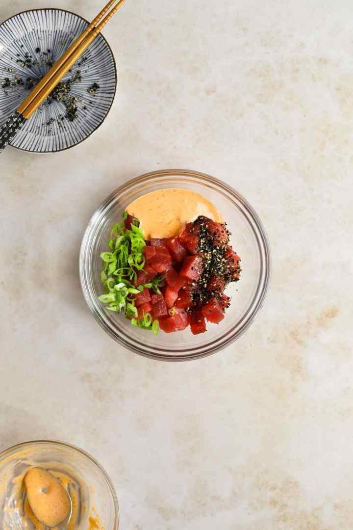 Spicy ahi tuna bowl: fresh tuna, furikake, spicy kewpie mayo, scallions. Like Foodland.
