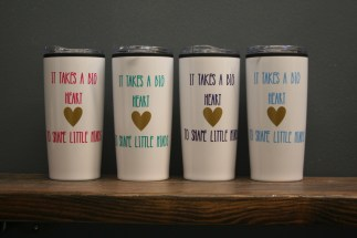 "Coffee mugs that say ""It takes a big heart to shape a little mind"""