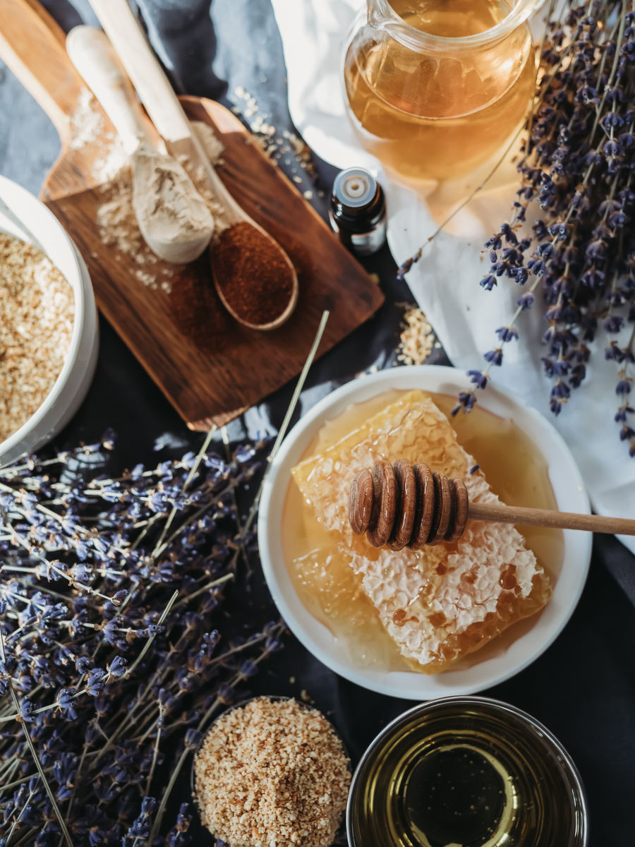 honey and skincare ingredients on table with lavender