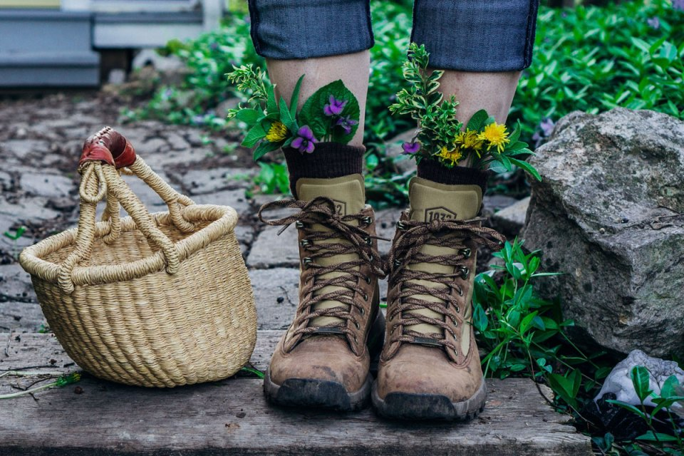 wild food and herb tucked into woman's boots