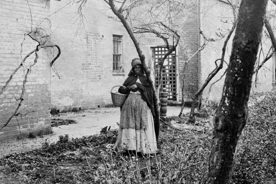 young slave girl holding a basket
