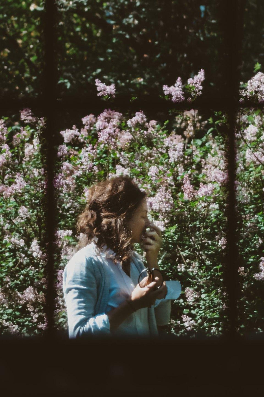 Ashley York near flowering bush