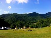 The beautiful Bell's Cove near Pisgah National Forest where the Firefly Gathering was held over the weekend of the Summer Solstice. This outdoor gathering is a chance to share and learn primitive, permaculture and homesteading techniques, and other earth-friendly skills.