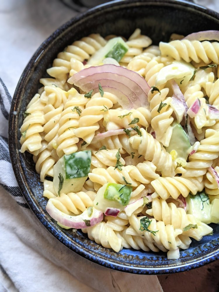 vegan creamy pasta salad recipe homemade with cucumbers from garden recipe healthy easy homemade meal prep make ahead pasta salad for summer bbq