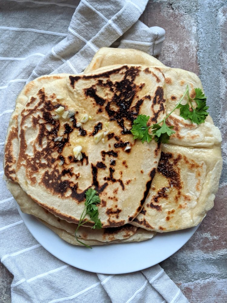 homemade garlic naan recipe with sourdough discard starter vegan egg free dairy free healthy homemeade naan in cast iron skillet