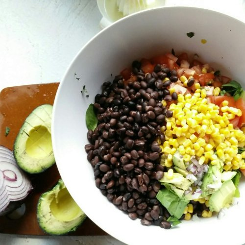 taco tuesday salad with avocado black beans corn red onion and a lime vinaigrette healthy spinach salads southwest dressing vegan vegetarian gluten free meatless side dishes with tacos