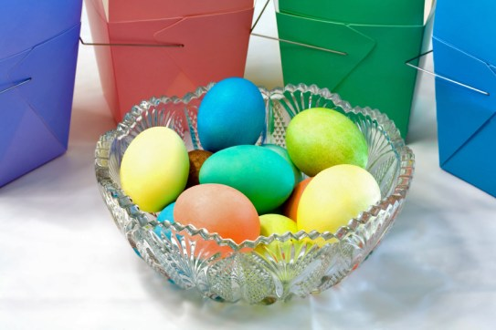 Glass bowl filled with brightly colored Easter Eggs