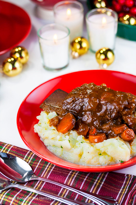 red wine braised short ribs served over garlic mashed potatoes for a wonderful comfort food holiday meal