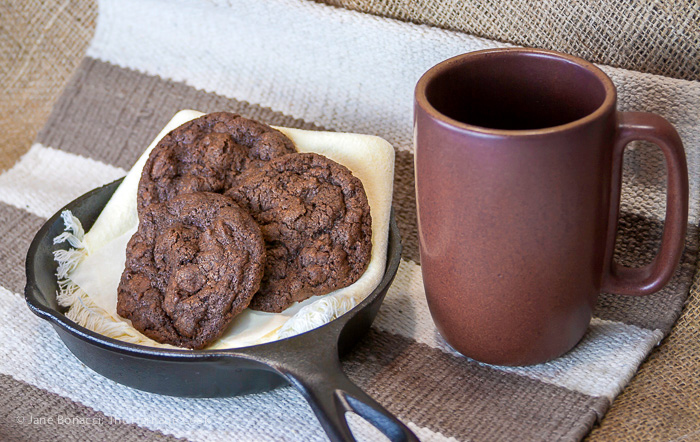 Gluten-Free Bacon Double Chocolate Chip Cookies in cast iron skillet on rustic setting