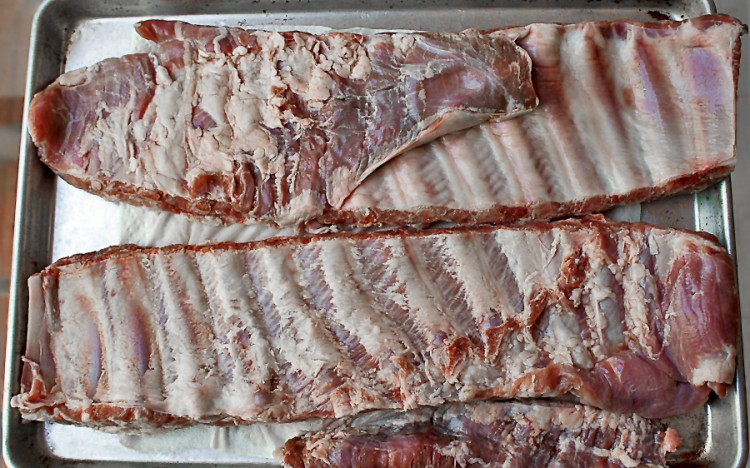 Prepping ribs is easy; the rack on the top as I bought it; the rack on the bottom after the flap and silverskin are removed