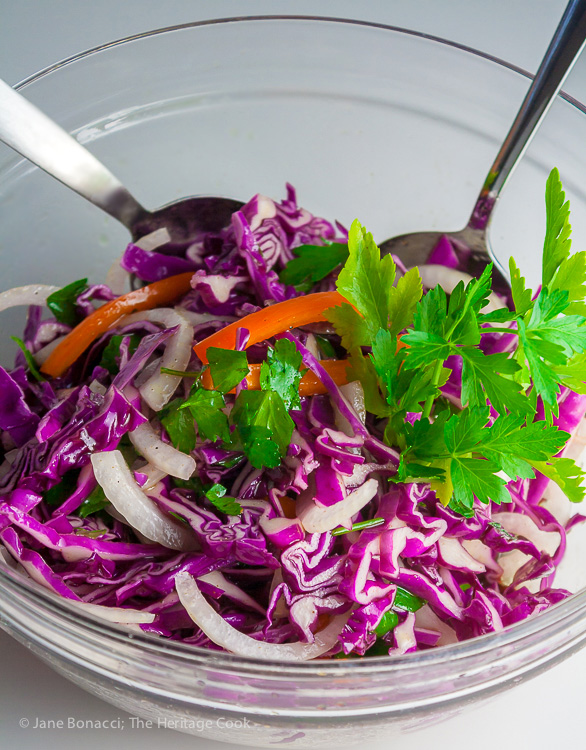 Red cabbage and onions before being tossed with the green cabbage