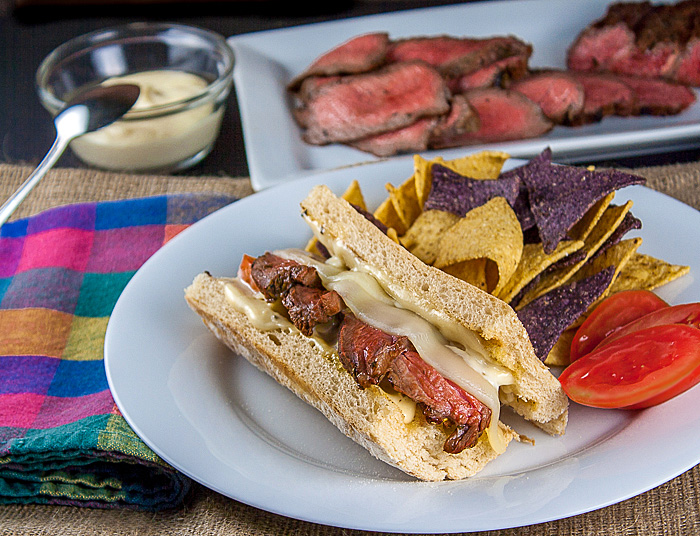 BBQ Steak covered with melted cheese and more in these amazing sandwiches perfect for tailgating or any party; Cheesy Grilled Steak Sandwiches; 2015 Jane Bonacci, The Heritage Cook