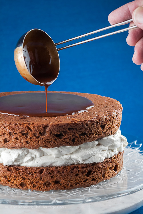 Pouring chocolate ganache over the cake; Chocolate Layer Cake with Whipped Cream Filling; © 2015 Jane Bonacci, The Heritage Cook