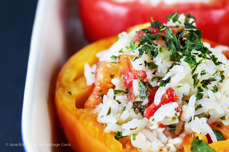 A sprinkling of herb on top of the stuffing not only adds flavor but makes these beautiful too. Rice and Cheese Stuffed Roasted Tomatoes (Gluten-Free); 2015 Jane Bonacci The Heritage Cook