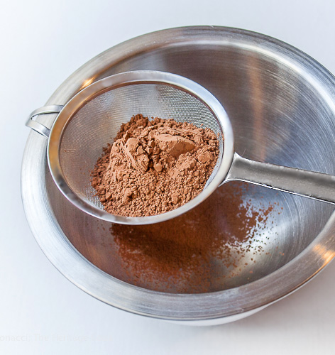 Wire sieve with cocoa powder ready for sifting; Chocolate and Vanilla Meringues with a Surprise Inside; 2015 Jane Bonacci, The Heritage Cook
