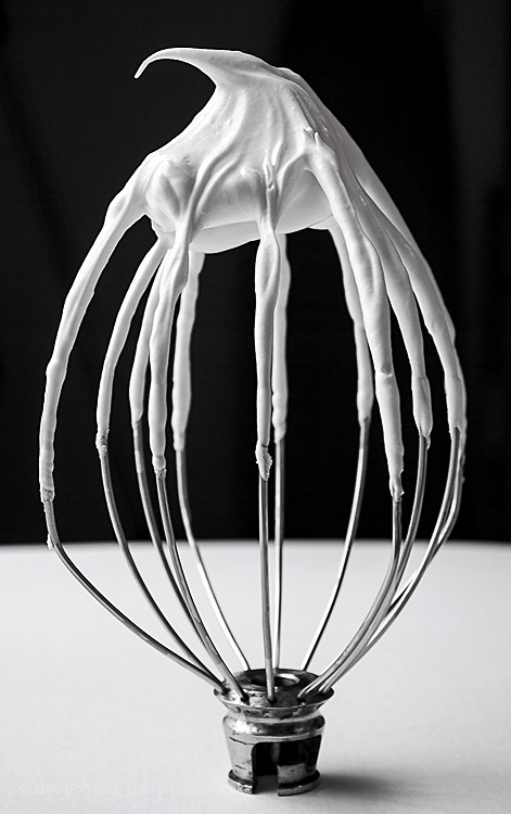 Meringue standing up on a whisk; Chocolate and Vanilla Meringues with a Surprise Inside; 2015 Jane Bonacci, The Heritage Cook