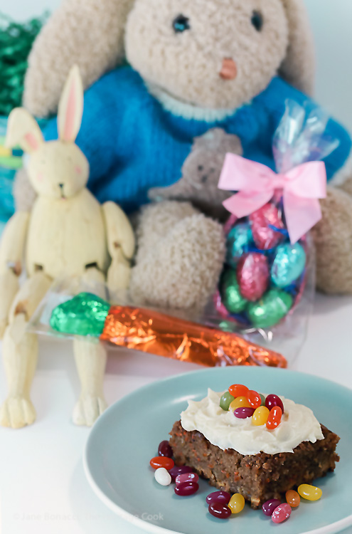 Stuffed bunnies and bright candies make a festive table; White Chocolate Studded Carrot Cake with Cream Cheese Frosting for Easter; © 2016 Jane Bonacci, The Heritage Cook