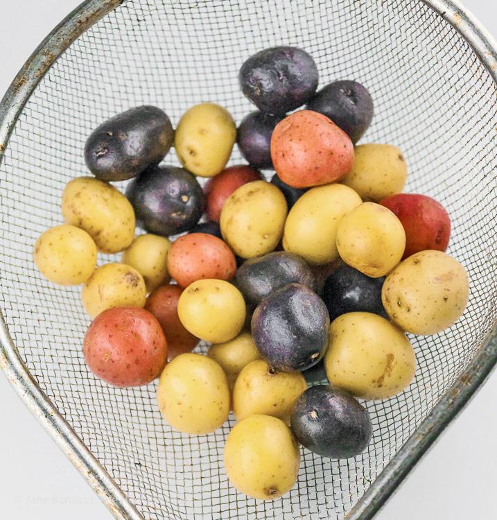 Use mini multi-colored potatoes; Potato, Spring Vegetable, and Bacon Salad with Lemon Vinaigrette; © 2019 Jane Bonacci, The Heritage Cook