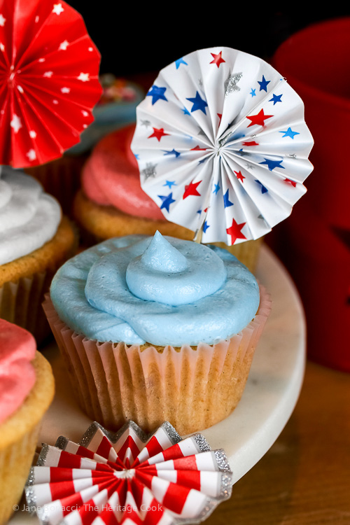 Collection of red, white, and blue cupcakes with 4th of July decorations
