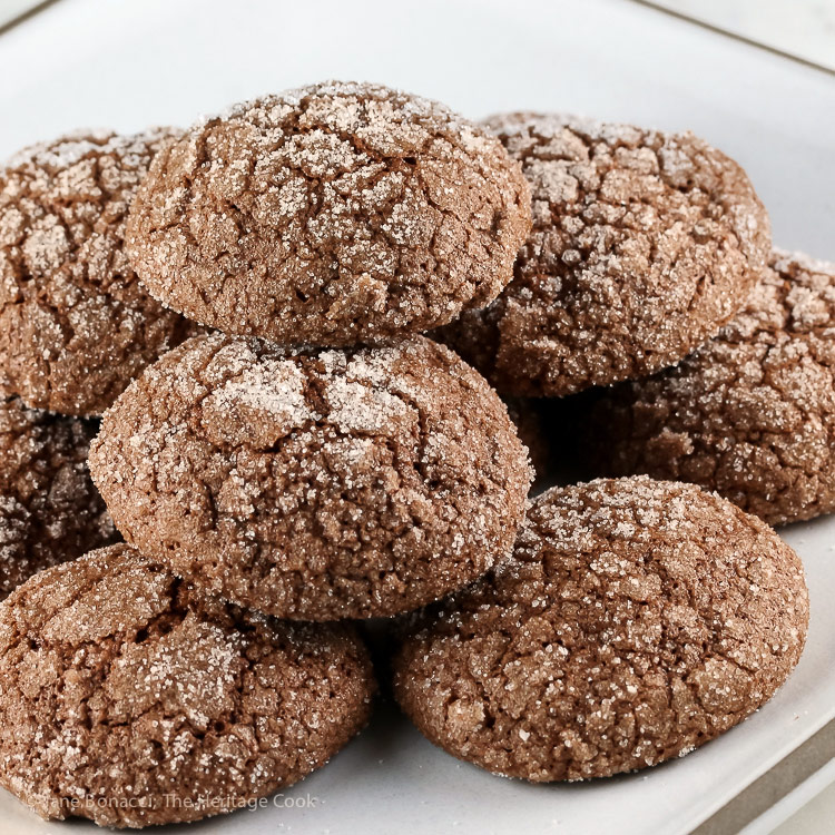 Close up of a plate piled with cookies; Dark Chocolate Bourbon Crackle Cookies © 2017 Jane Bonacci, The Heritage Cook