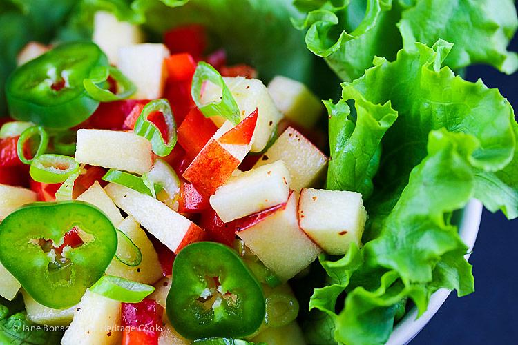 bowl of pinata apple salsa on lettuce; Stemilt Piñata Apple Salsa with Pork Tacos © 2018 Jane Bonacci, The Heritage Cook