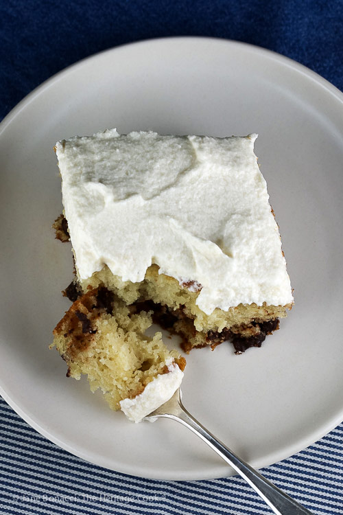 top down angle on single slice of cake in plate with bite on a fork; Chocolate Chip Dalmatian Sheet Cake with Vanilla Buttercream Frosting © 2018 Jane Bonacci, The Heritage Cook
