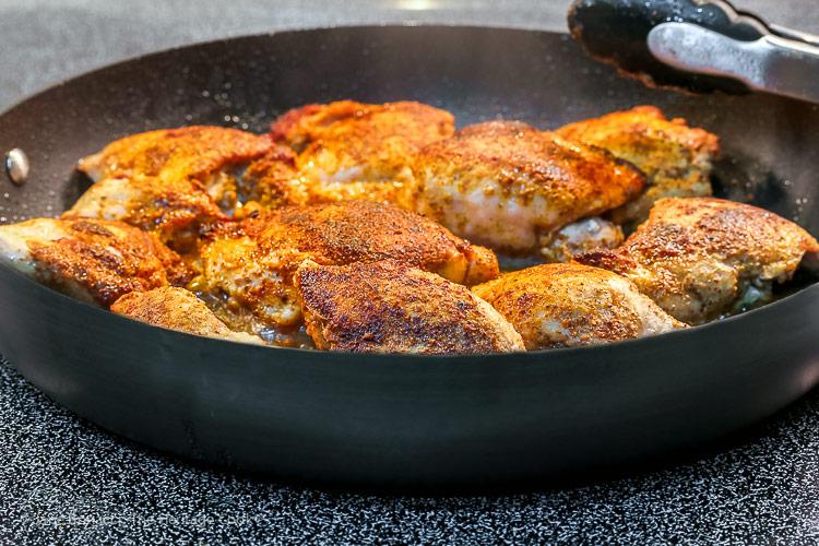 frying the chicken in a skillet; Gluten Free Mediterranean Chicken Dinner © 2018 Jane Bonacci, The Heritage Cook